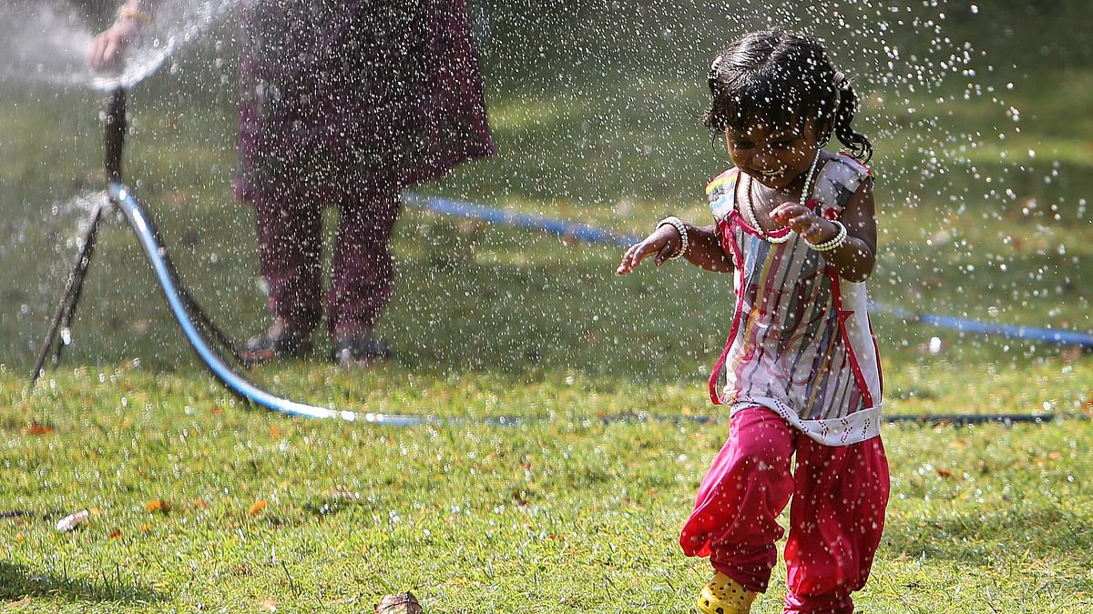 File photo of child playing in a sprinkler in hot weather conditions.(Photo Courtesy: AP)