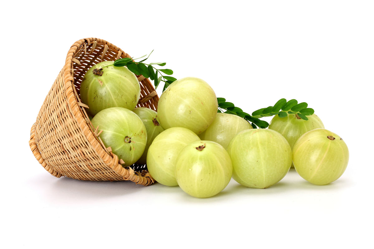 Gooseberries spilling out of a basket. (iStockphoto)