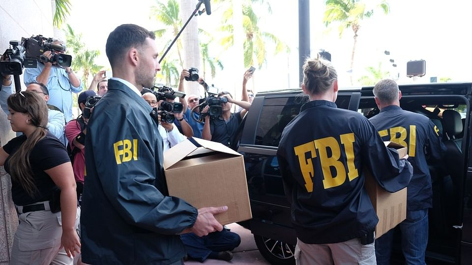 FBI agents carry boxes from the offices of CONCACAF, the soccer federation that governs North America, Central America and the Caribbean, in Miami Beach on Wednesday. (Photo: Reuters)