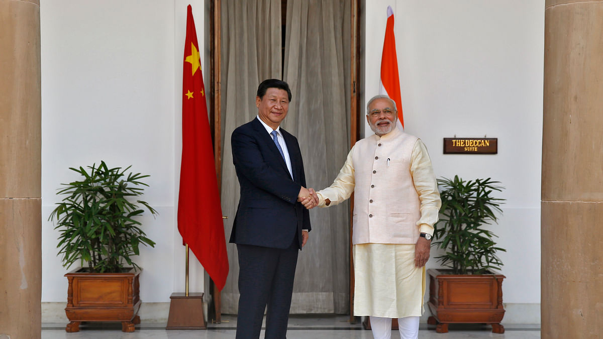 Prime Minister Narendra Modi and China's President Xi Jinping shake hands ahead of their meeting in New Delhi September 18, 2014. (Photo: Reuters)<!--EndFragment-->
