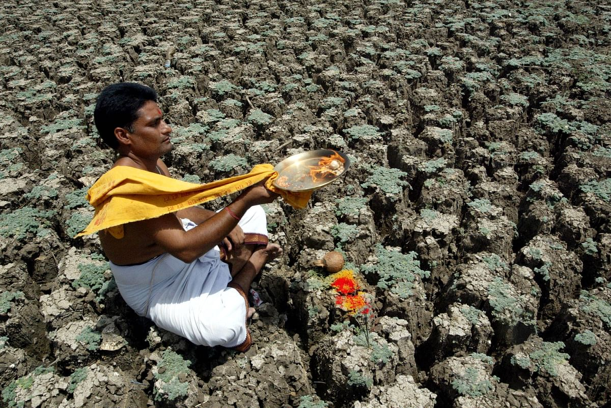 A priest performs rituals for monsoons to arrive early near Hyderabad. (Photo: Reuters)
