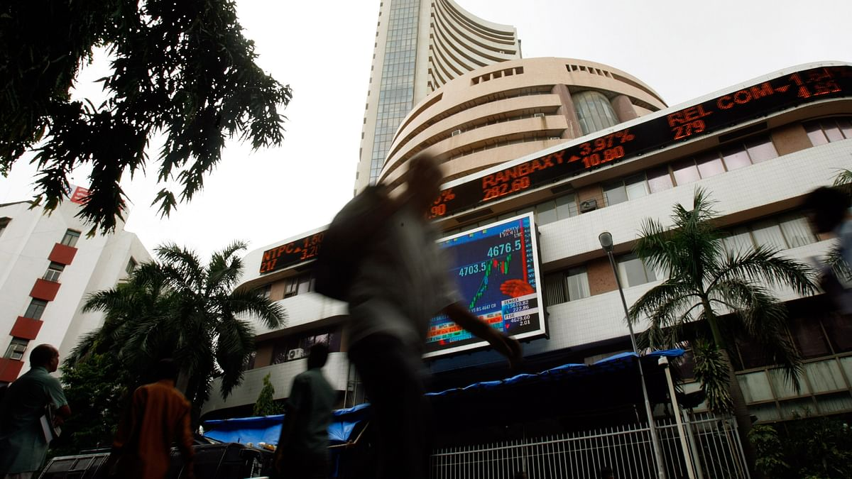 People walk pass the Bombay Stock Exchange (BSE) building displaying India?s benchmark share index on its facade, in Mumbai. (Photo: Reuters)