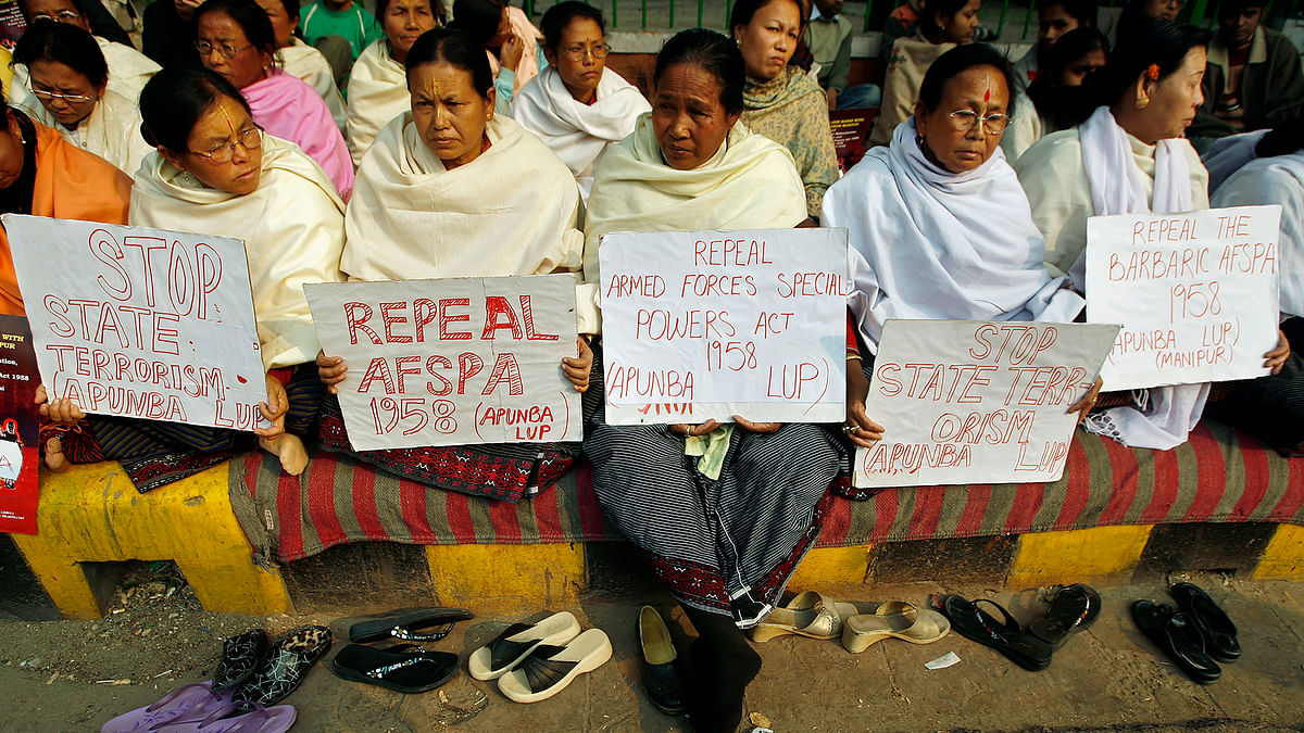 Women hold placards during a protest against the Armed Forces Special Powers Act (AFSPA).