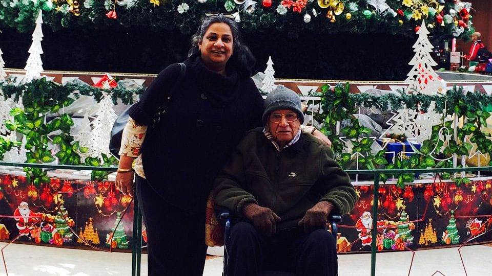 Sangeeta Murthi Sahgal at a city mall with her father who was diagnosed with Parkinson's Disease in 2008.  (Photo Courtesy: Sangeeta Murthi Sahgal)