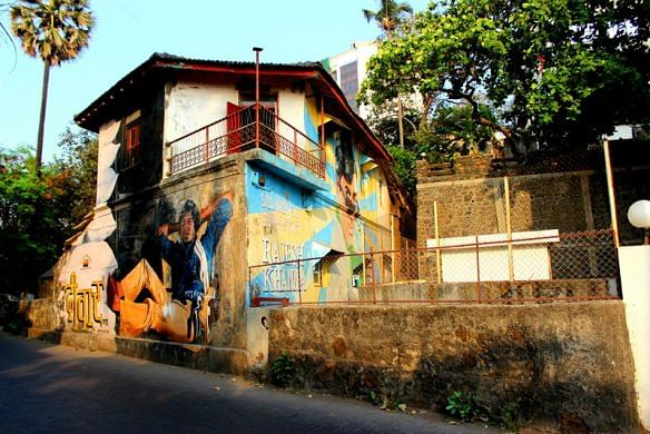Back to back hits: Amitabh Bachchan and Rajesh Khanna murals on adjacent walls of the same Bandstand house. (Photo: Facebook/Bollywood Art Project)