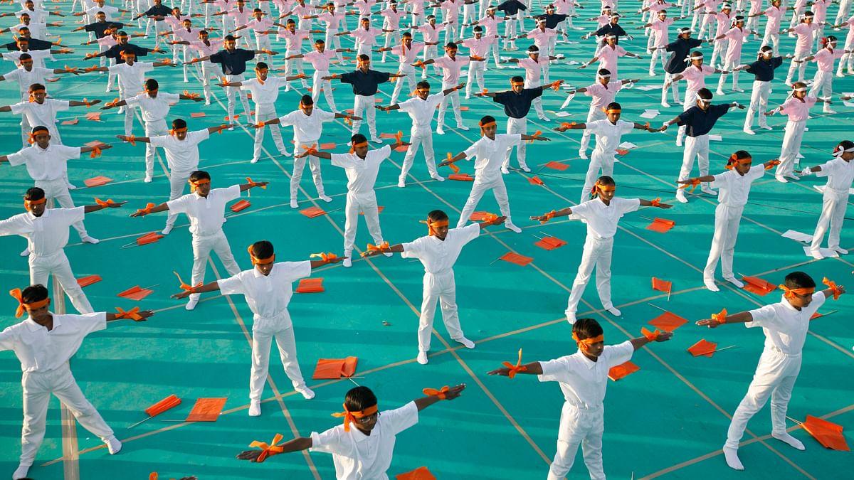 School children attending a yoga exercise session. (Photo: Reuters)