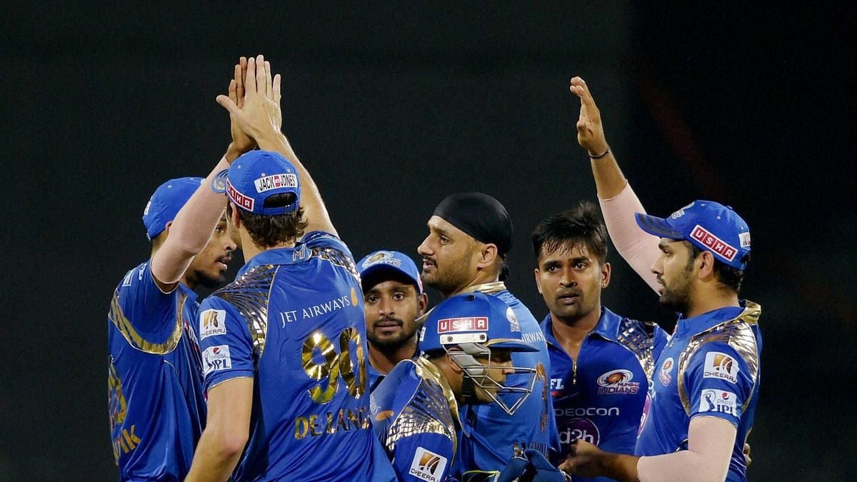 Mumbai Indians with skipper Rohit Sharma(R) celebrate a wicket in their match against CSK on Friday.(Photo: BCCI/PTI)