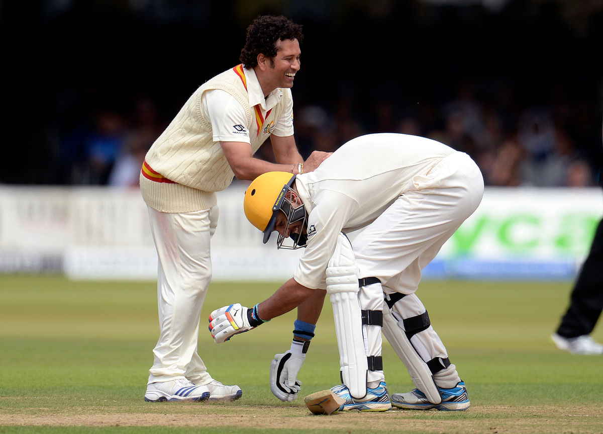 MCC's captain Sachin Tendulkar smiles as Rest of the World's Yuvraj Singh attempts to grab his leg during a cricket match to celebrate 200 years of Lord's at Lord's cricket ground in London. (Photo: Reuters)