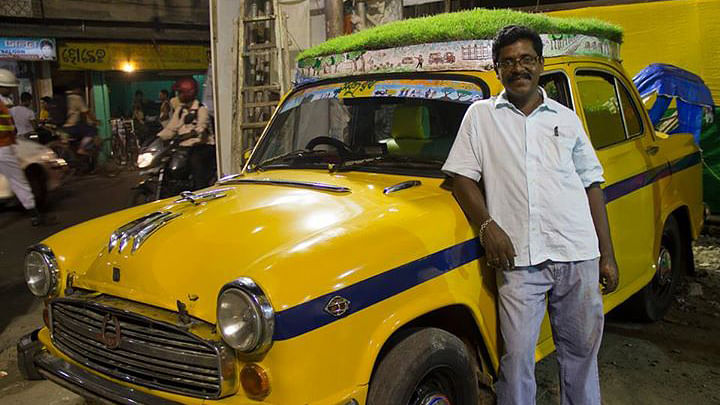 """40-year-old driver Dhananjay Charkaborty who operates the 'plant fitted' car calls it his 'Sobuj Rath' or Green Chariot. (Photo Courtesy: Facebook.com/<a href=""""https://www.facebook.com/profile.php?id=100008750044564"""">Bapi Green Taxi</a>)"""