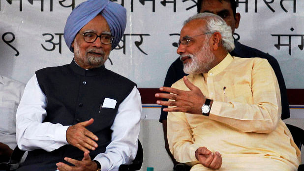 Former Prime Minister Manmohan Singh (left) with Prime Minister Narendra Modi (right), when he was the chief minister of Gujarat in Ahmedabad on 29 October  2013. (Photo: Reuters)