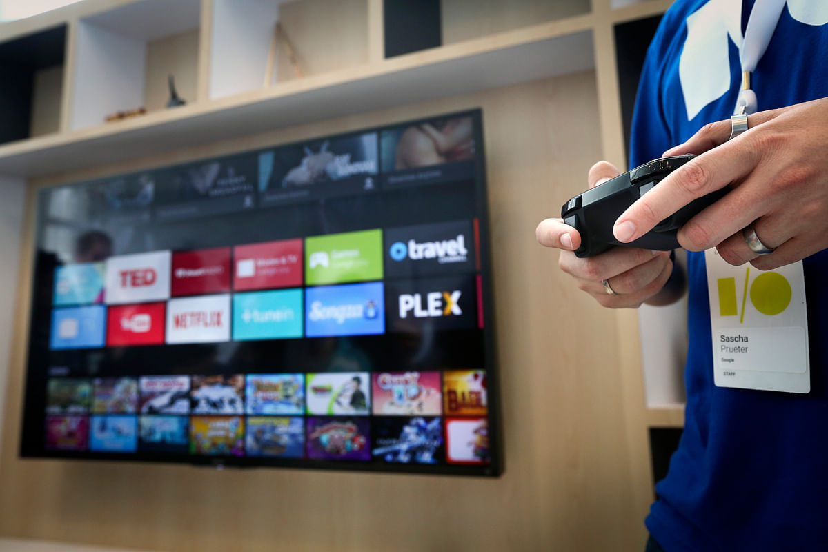A Google employee  uses a game controller to demonstrate the features of the newly-announced Android TV. (Photo: Reuters)