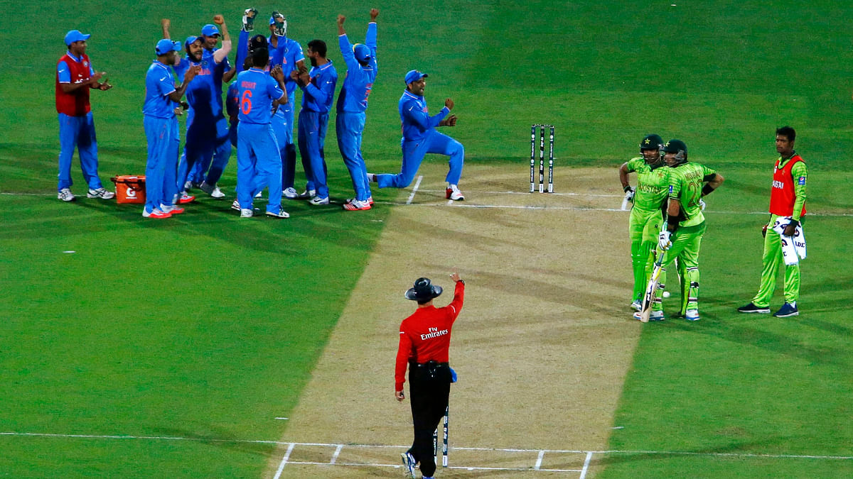 File picture of Indian players celebrating the fall of a wicket during their 2015 World Cup clash with Pakistan.