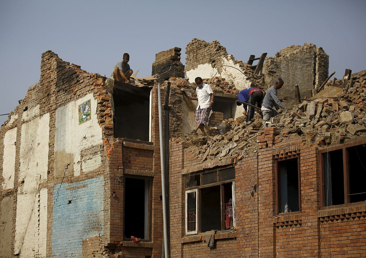 People work to clear debris from collapsed houses, a month after the April 25 earthquake in Bhaktapur. (Photo: Reuters)
