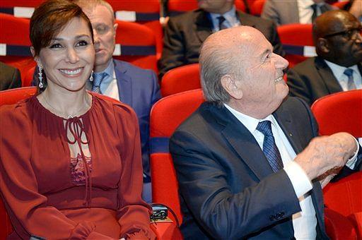Sepp Blatter (R), sits next to his girlfriend Linda Gabrielian. (Photo: AP)