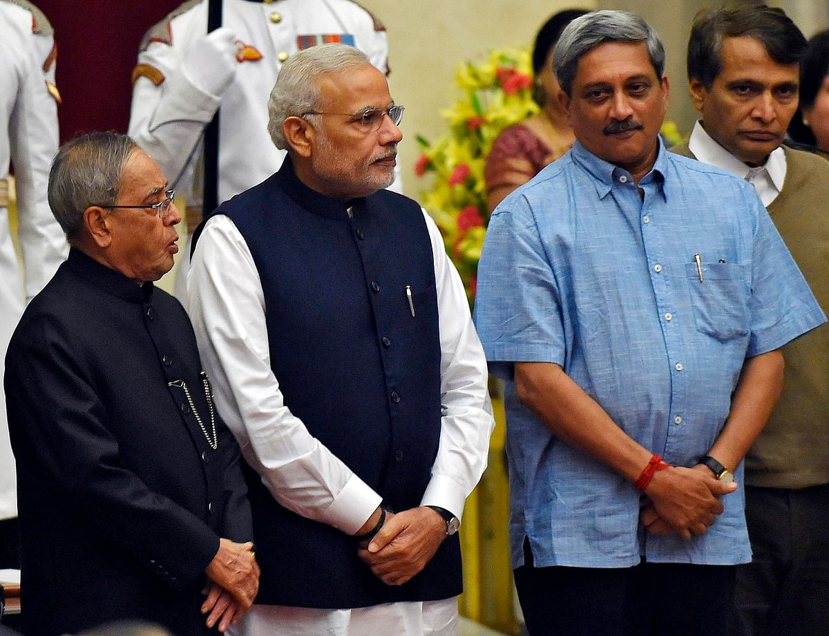 (From L to R) President Pranab Mukherjee, PM Narendra Modi, Defence Minister Manohar Parrikar, and Suresh Prabhu  after the swearing-in ceremony at the presidential palace in  November, 2014. (Photo: Reuters)