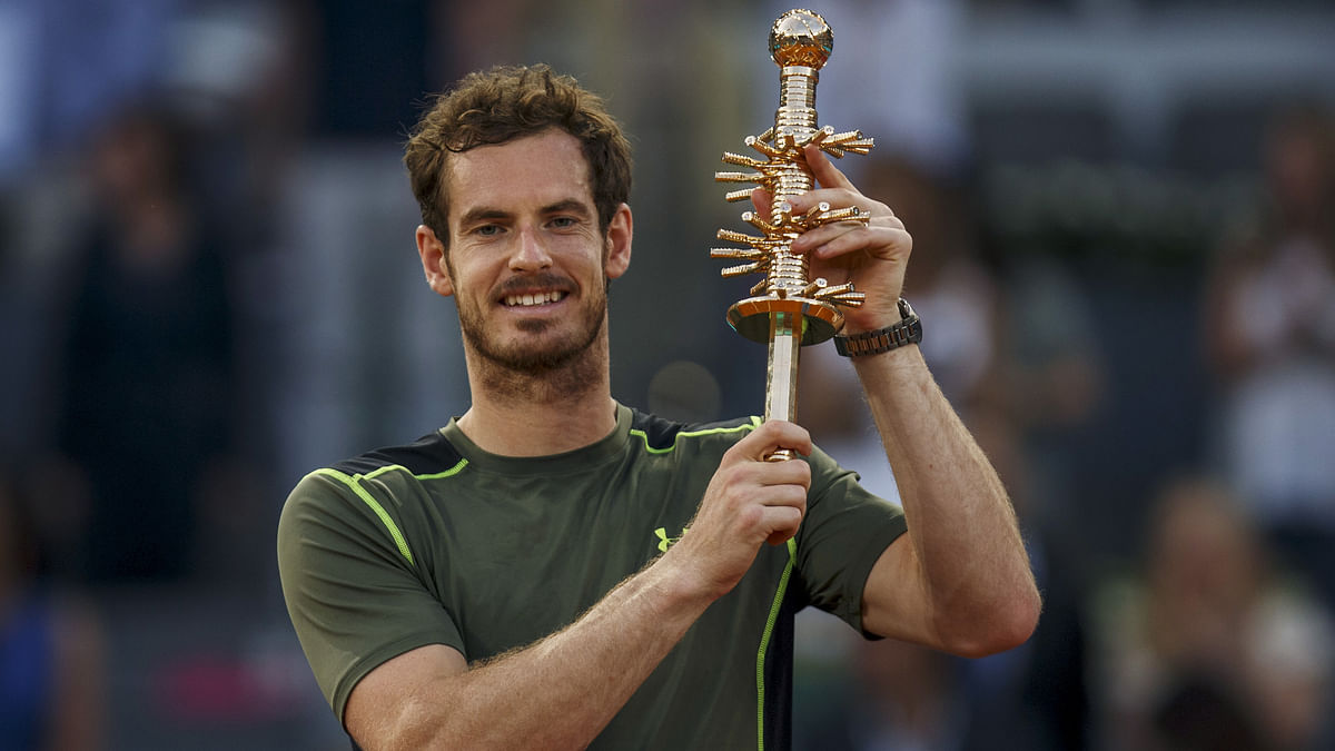 Britain's Andy Murray raises his trophy after winning the final match over Spain's Rafael Nadal at the Madrid Masters. (Photo: Reuters)