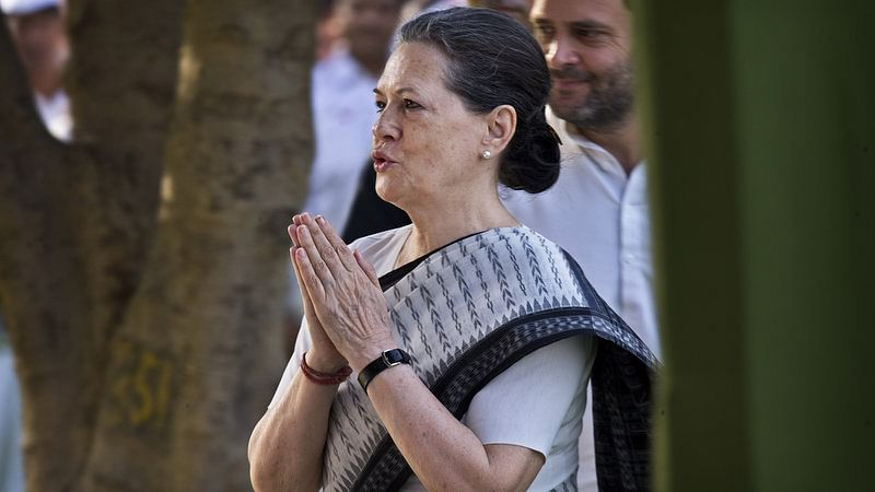 Congress President Sonia Gandhi greets the gathering after paying homage to her late husband and former Prime Minister Rajiv Gandhi on his death anniversary in New Delhi, May, 2015. (Photo: AP)