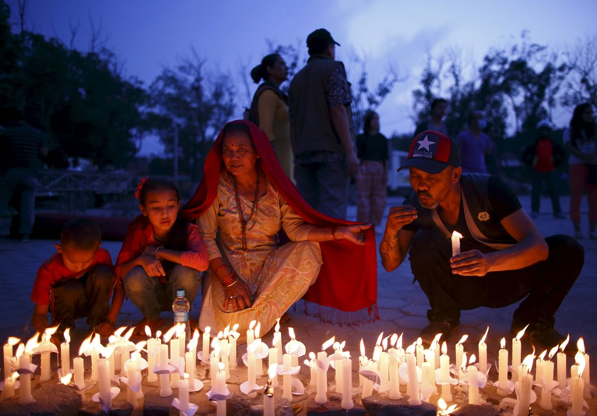 Nepalis take part in a candlelight vigil, a month after the April 25 earthquake in Kathmandu, Nepal. (Photo: Reuters)