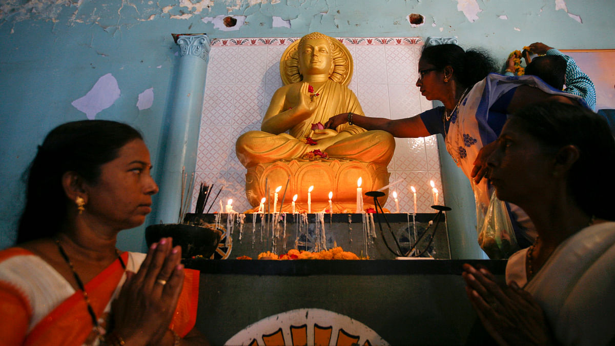 File photo: Devotees offer prayers inside a Buddhist temple on the occasion of Buddha Purnima festival in the western Indian city of Ahmedabad. (Photo: Reuters)<!--EndFragment-->