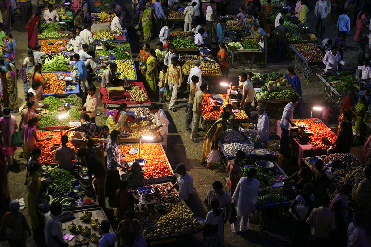Vendors use solar powered lights at an open air evening market as customers buy fruits and vegetables in the western Indian city of Ahmedabad. (Photo: Reuters)