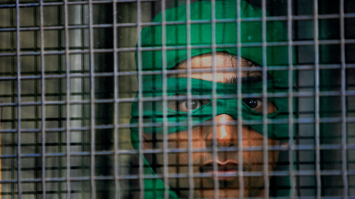 A Greenpeace activist in a police van. Picture is representational. (Photo: Reuters)