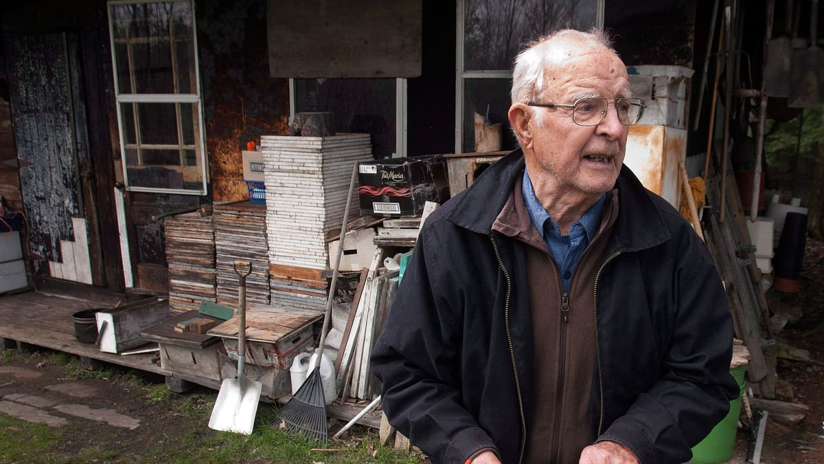 In this April 25, 2012, Vladimir Katriuk stands at his honeybee farm in Ormstown, Quebec. (Photo: AP)