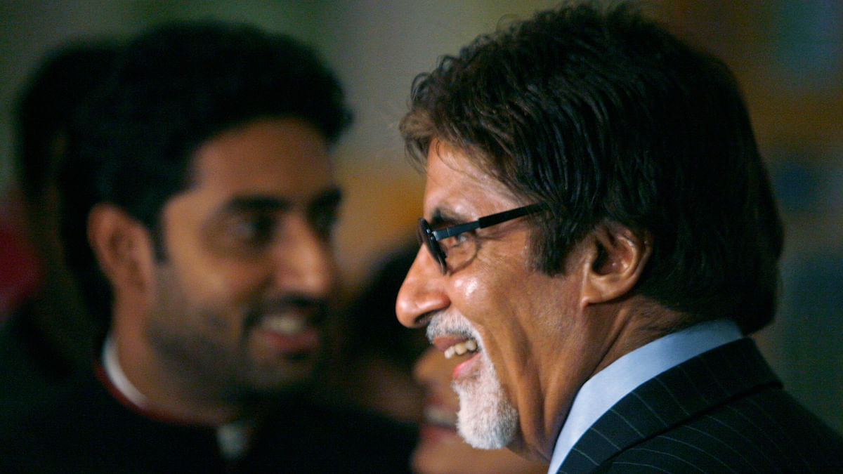 Bollywood actor Amitabh Bachchan and his son Abhishek Bachchan are in trouble for  wearing the Indian flag during the Cricket World Cup 2015. (Photo: Reuters)