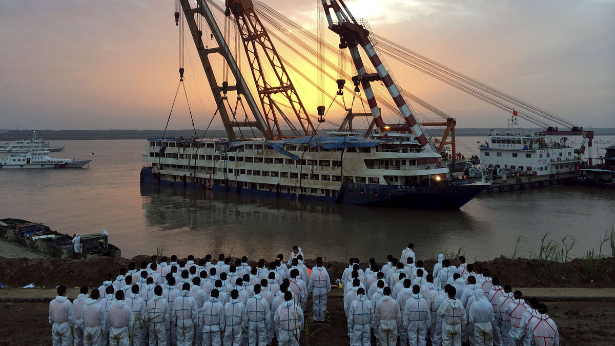 Chinese rescue workers look on after the Eastern Star, which sunk in the Yangtze River on Monday, was righted. (Photo: Reuters)