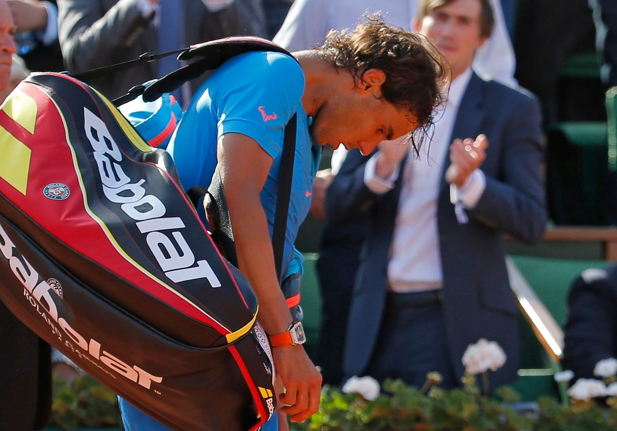Rafael Nadal of Spain leaves the court after being defeated by Novak Djokovic of Serbia during their men's quarter-final match at the French Open tennis tournament at the Roland Garros stadium in Paris, France, June 3, 2015. (Photo: Reuters)