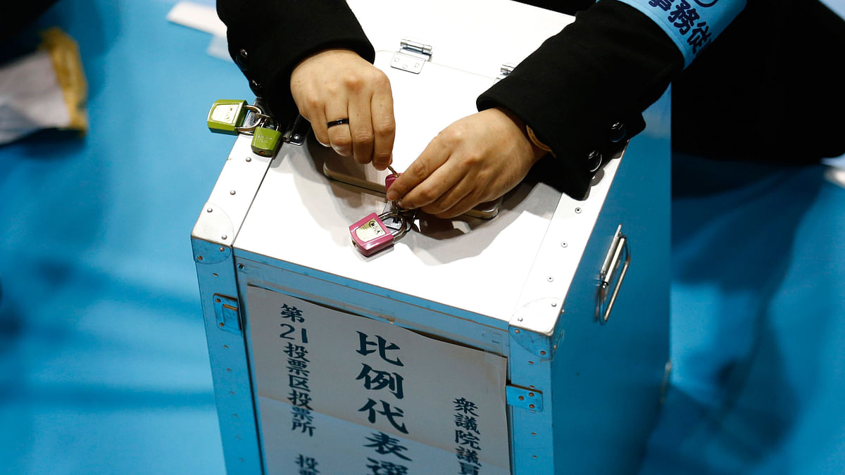 An election official unlocks a ballot box at a counting centre in Tokyo. (Photo: Reuters)