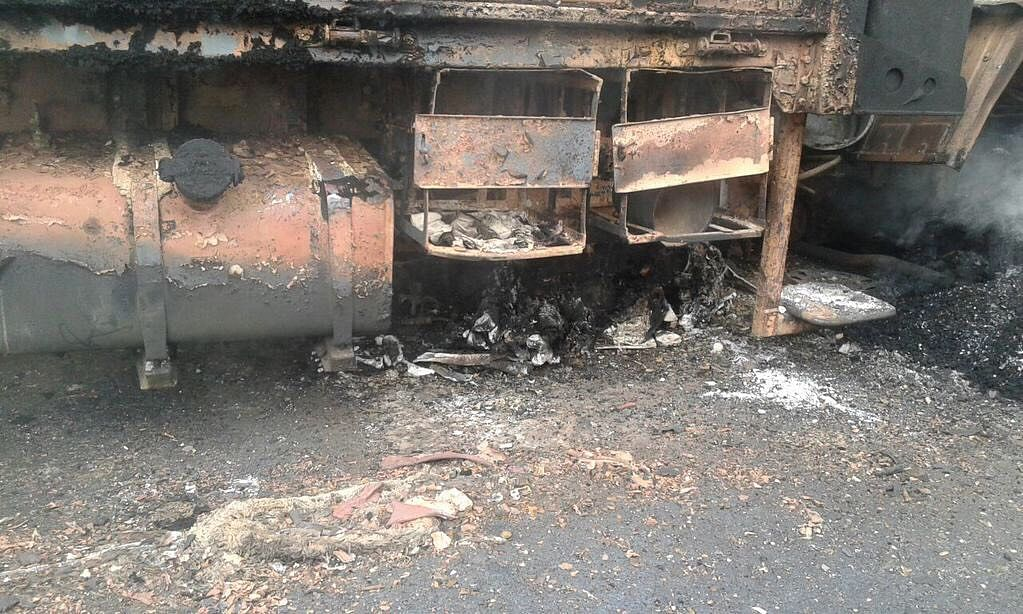 Charred remains of one of the Army trucks that caught fire in the ambush. (Photo ANI)