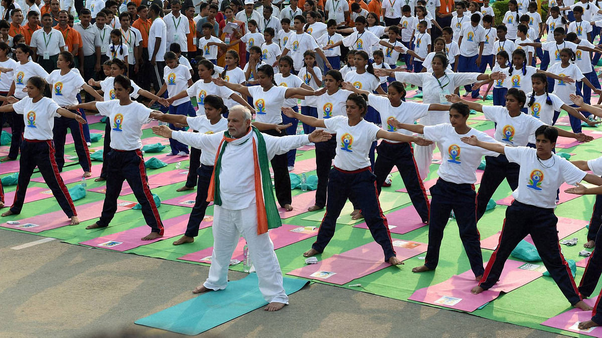 Prime Minister Narendra Modi performs yoga along with thousands of others at a mass yoga session to mark the International Day of Yoga 2015. (Photo: PTI)