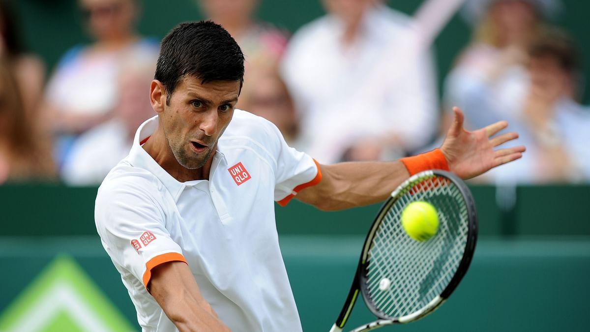 Novak Djokovic returns a shot in an exhibition match before the Wimbledon. (Photo: AP)