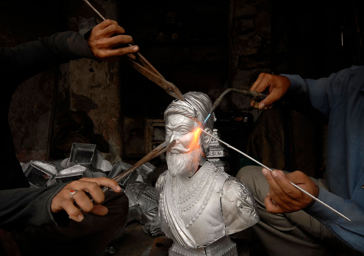 Craftsmen prepare a statue of Chhatrapati Shivaji, revered by many in western India as a Hindu warrior king who fought the Mughal empire and annexed land from its Muslim rulers in the 17th century, at a metal casting workshop in the southern Indian city of Hyderabad July 1, 2008