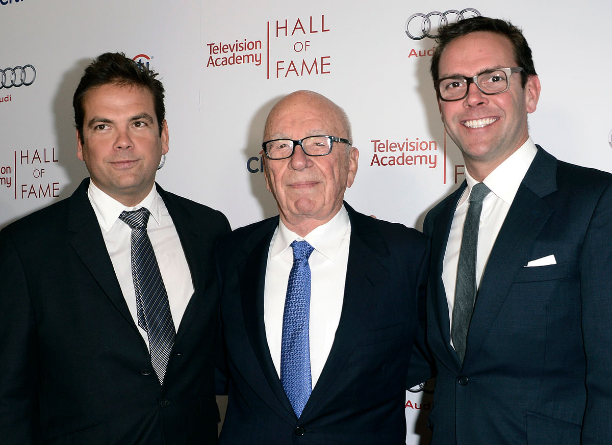 In this 11 March 2014 file photo, News Corp. Executive Chairman Rupert Murdoch (centre) and his sons, Lachlan (left) and James Murdoch attend the 2014 Television Academy Hall of Fame in Beverly Hills, California.