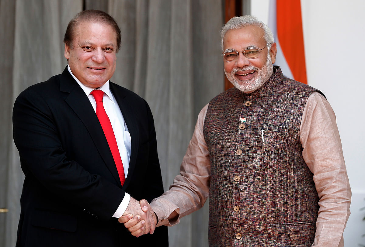 India's Prime Minister Narendra Modi (R) shakes hands with his Pakistani counterpart Nawaz Sharif before the start of their bilateral meeting in New Delhi. (Photo: Reuters)