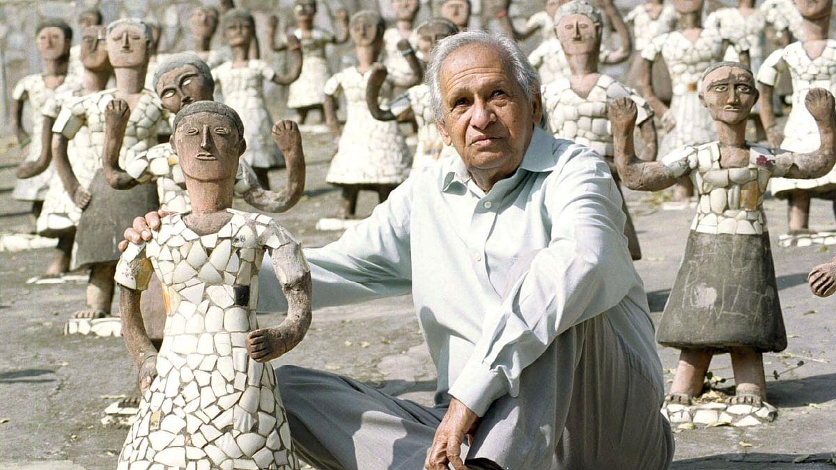Nek Chand, sits among idols in his Rock Garden in Chandigarh
