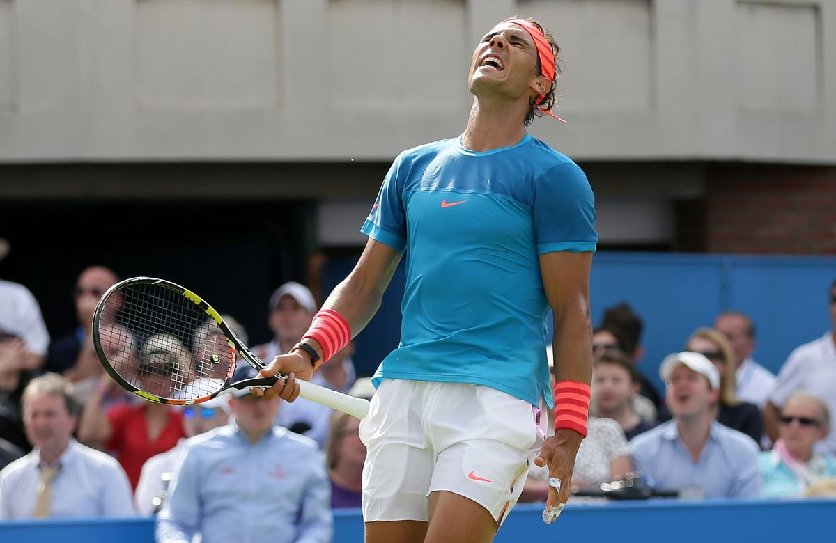 Rafael Nadal reacts after missing a shot in his Queen's opener. (Photo: AP)