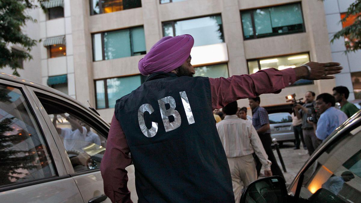 A Central Bureau of Investigation (CBI) official gestures after conducting a raid in New Delhi.