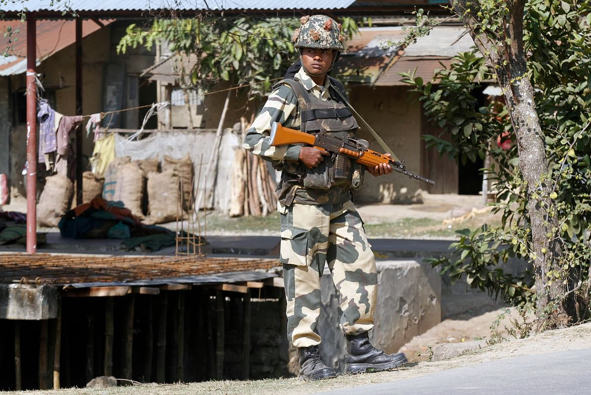 A member of the security forces stands guard along a roadside in Imphal. (Photo: Reuters)