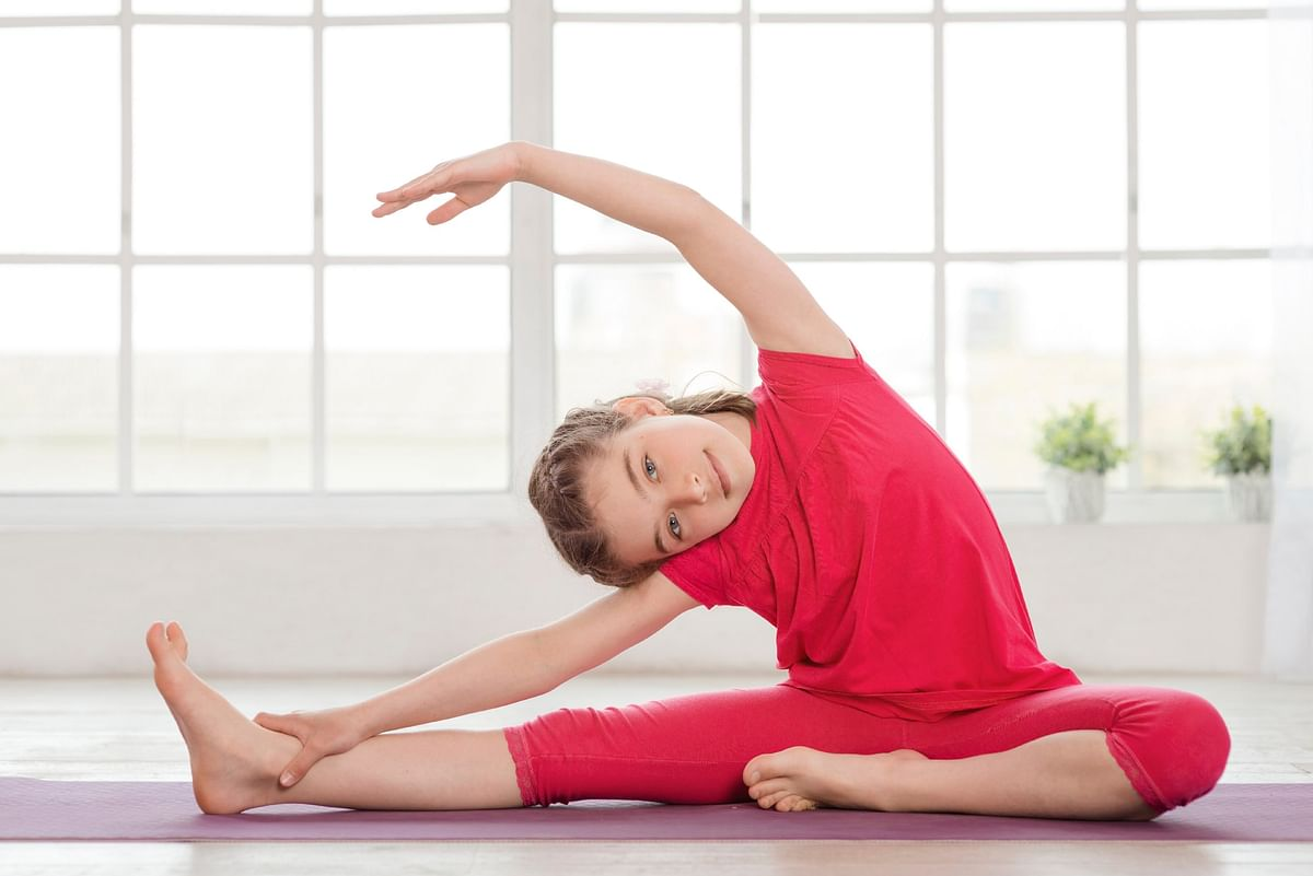 """Have some """"healthy"""" family time. Enrol your kids for a yoga class (Photo: iStock)"""