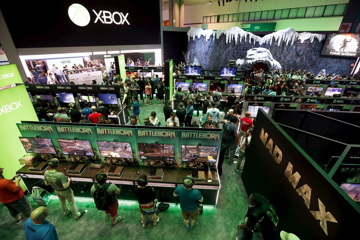 People play video games at the Microsoft Xbox booth at the Electronic Entertainment Expo,in Los Angeles, California (Photo: Reuters)