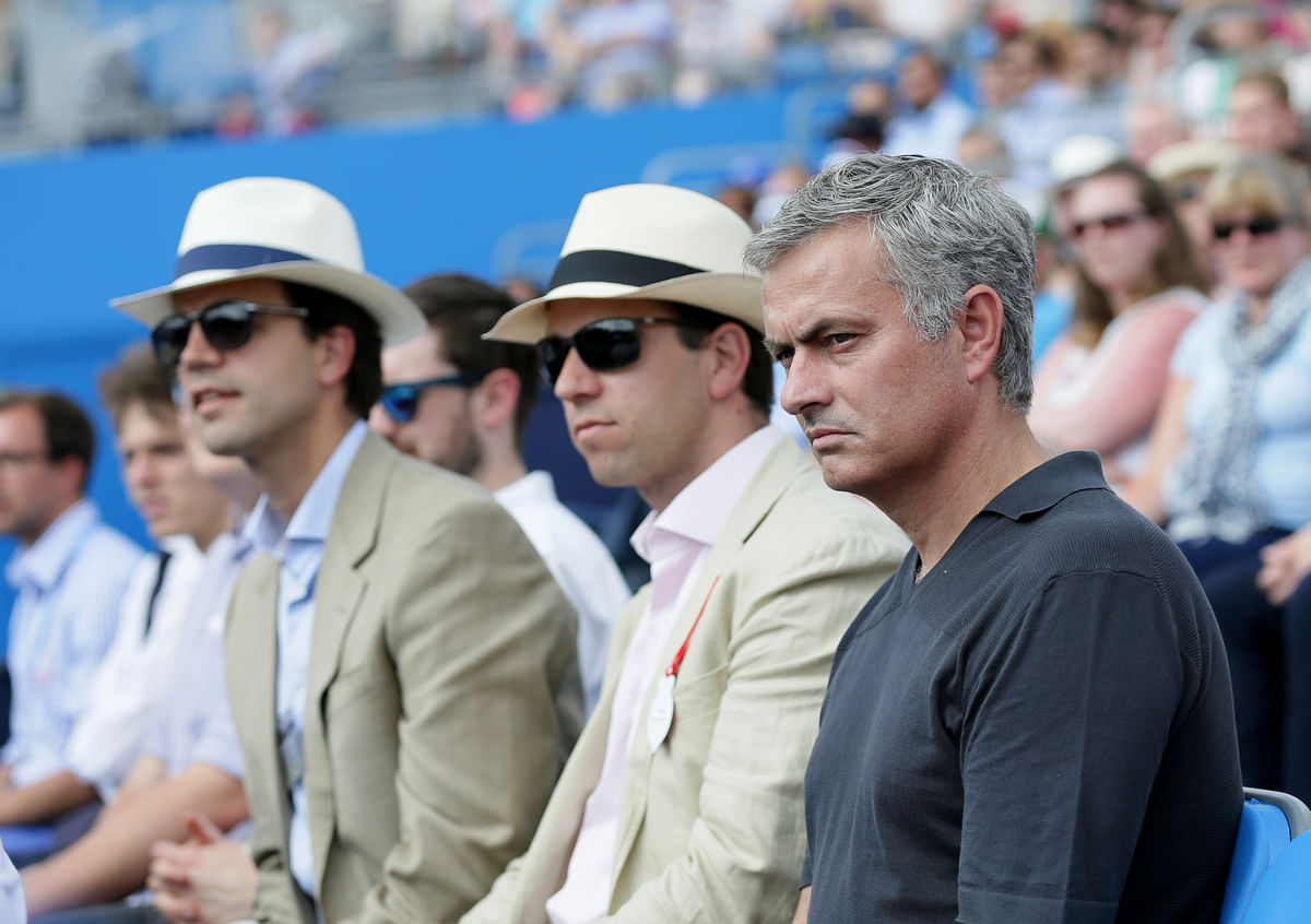 Chelsea soccer manager Jose Mourinho, right, watches the men's singles tennis match between Spain's Rafael Nadal and Ukraine's Alexandr Dolgopolov at Queen's tennis championship in London. (Photo: AP)