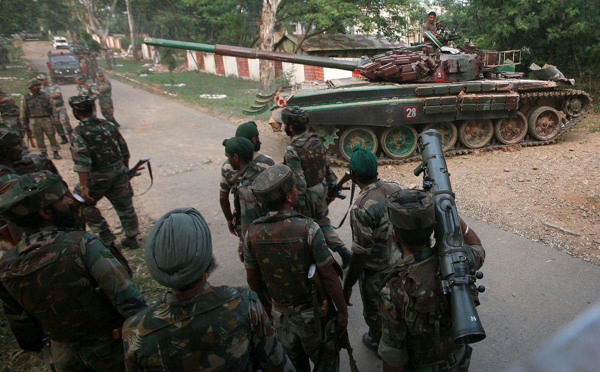 File photo of an Indian army tank, movingpast soldiers during a search operation. (Photo: Reuters)