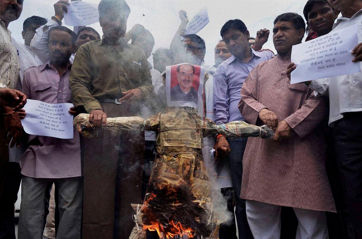 Congress activists burning an effigy of Madhya Pradesh Chief Minister Shivraj Singh Chouhan in Bhopan on Monday. PTI photo