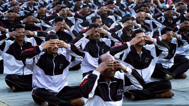 """Indian army officers doing Yoga. (Photo Courtesy: <i><a href=""""http://total-yoga.org/yoga-news-daily-13-apr-15/"""">Total-yoga.org</a></i>)"""