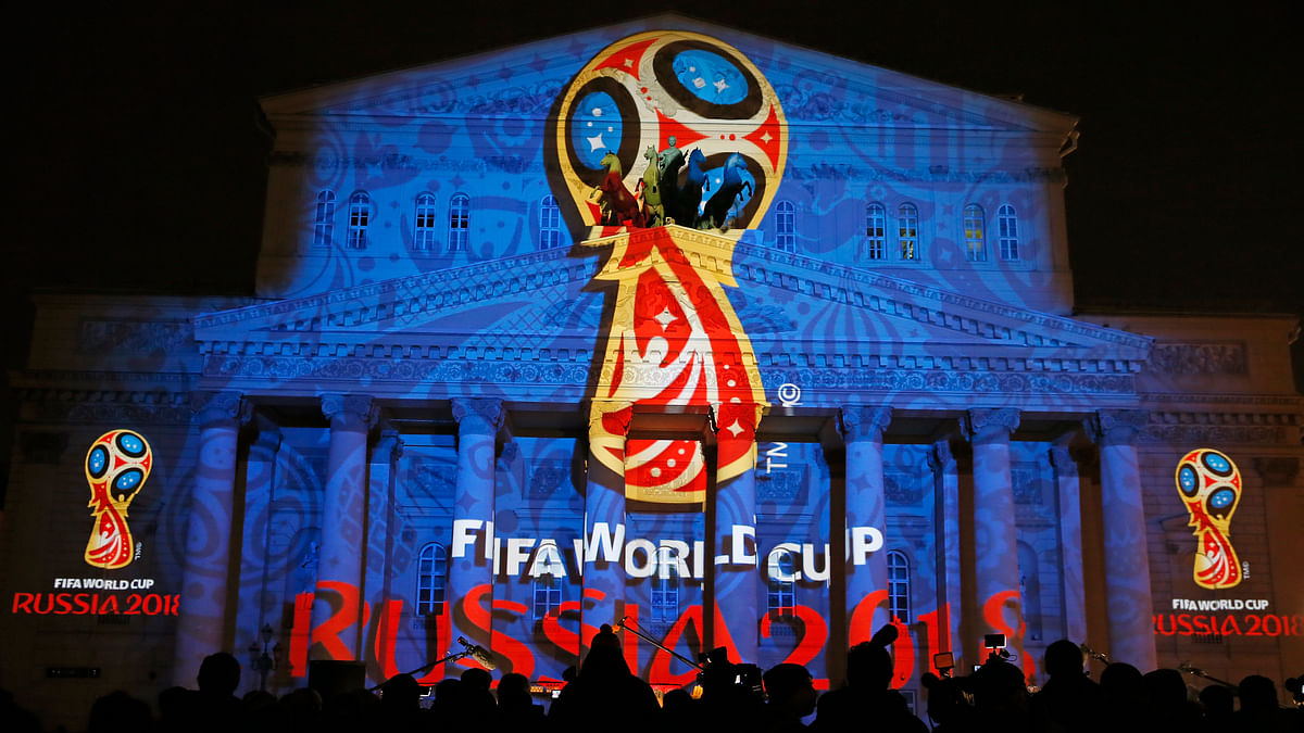 A light installation showing the official logotype of the 2018 FIFA World Cup during its unveiling ceremony at the Bolshoi Theater building in Moscow.