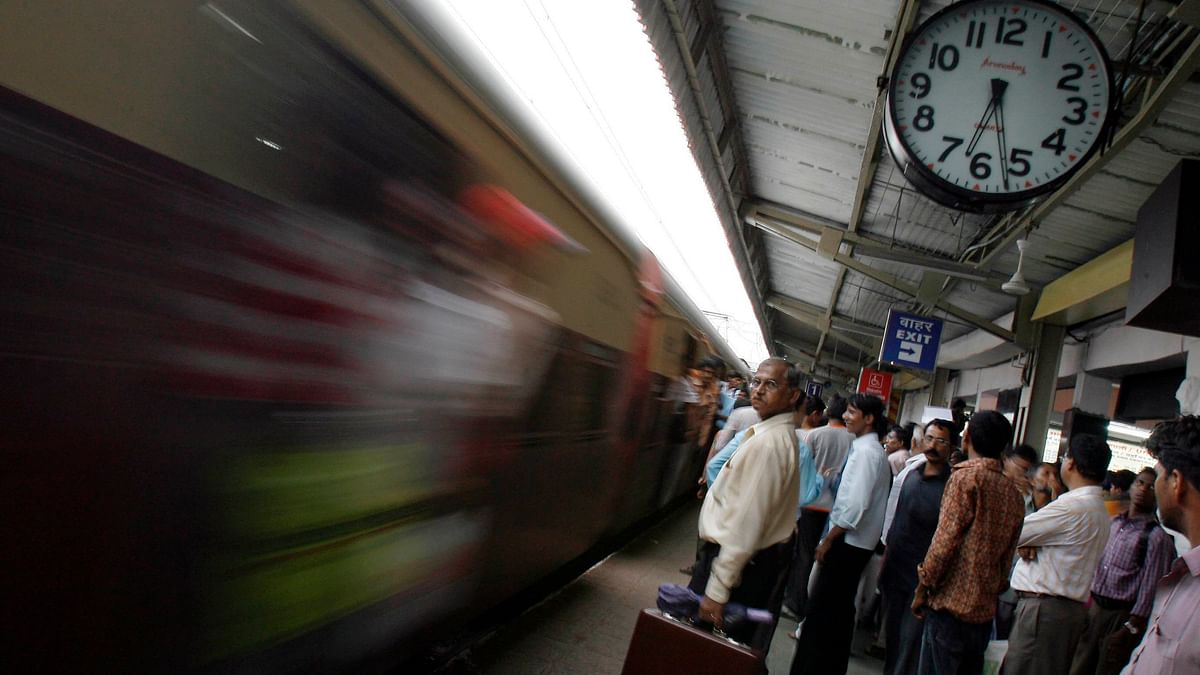A local train whizzes past at a Mumbai station (Photo: Reuters)