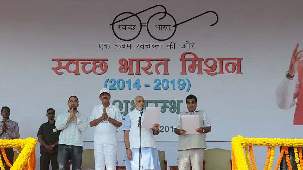 Prime Minister Narendra Modi (centre) at the launch of the Swacch Bharat (Clean India) Mission in New Delhi on October 2, 2014. <b>Image:</b> PIB