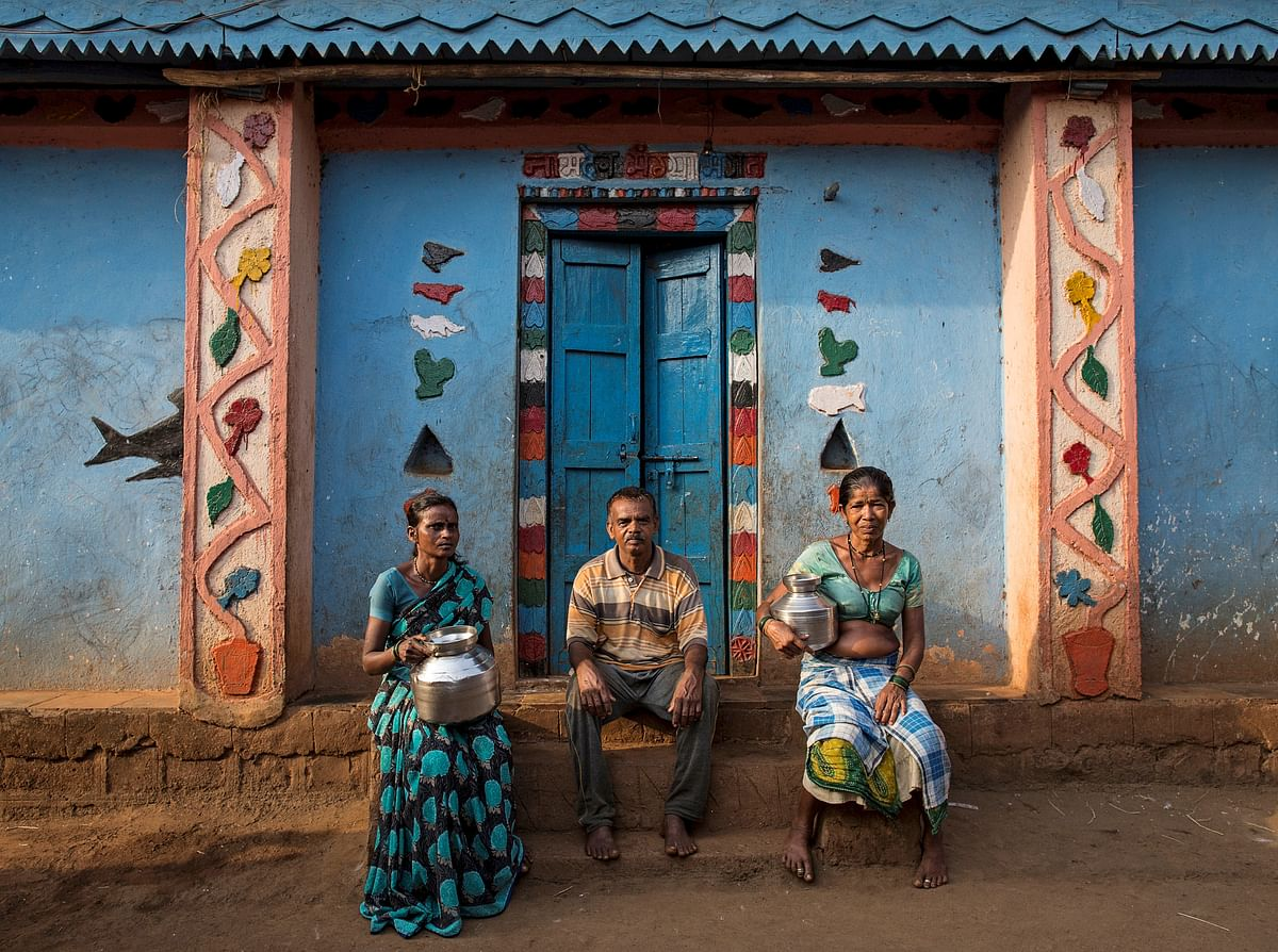 Namdeo poses with his wives Shivarti (L) and Bagabai (R) outside their house in Denganmal village, Maharashtra, India, April 21, 2015. (Photo: Reuters)